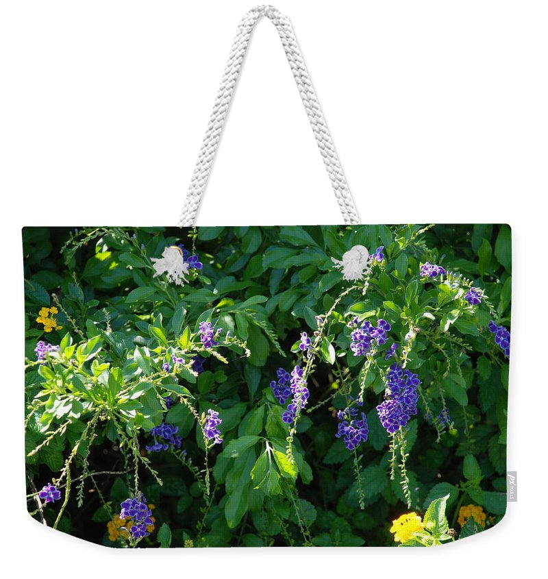 Floral Weekender Tote Bag featuring the photograph Purple Hanging Flowers by Rob Hans