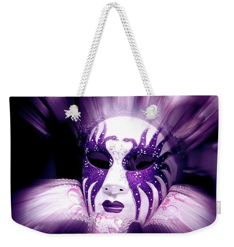 Purple Weekender Tote Bag featuring the photograph Purple Mask Flash by Amanda Eberly-Kudamik