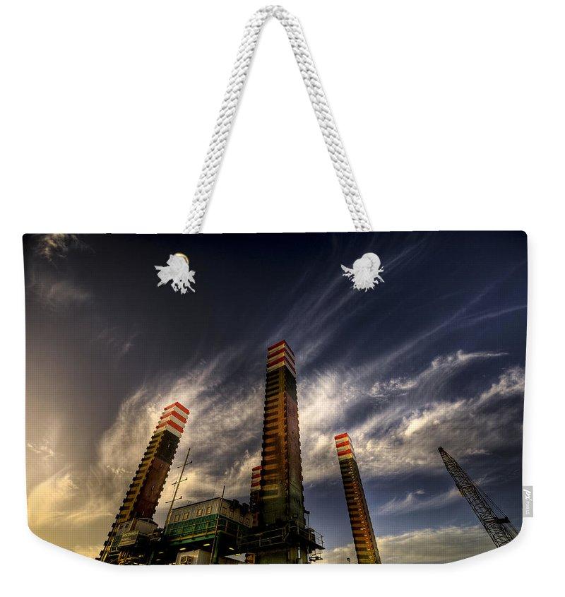 Pylons Weekender Tote Bag featuring the photograph Pylons by Wayne Sherriff