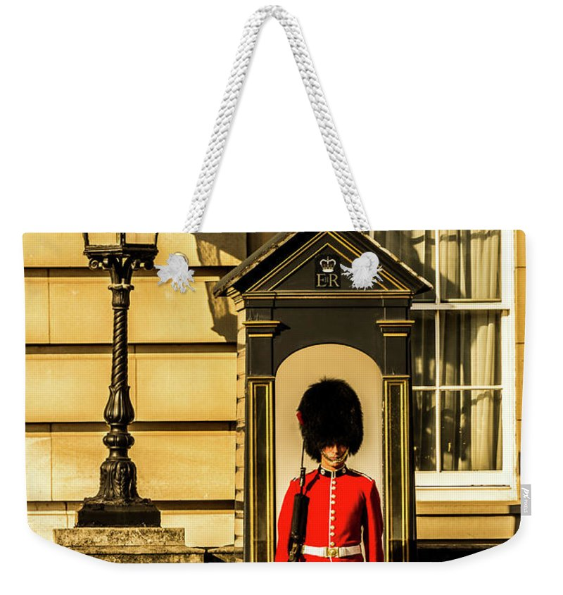 Queen Weekender Tote Bag featuring the photograph Queens Guards. by Nigel Dudson