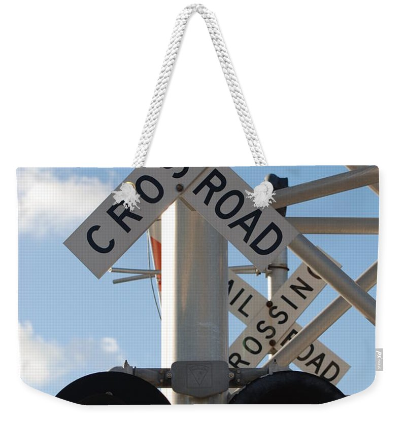 Train Weekender Tote Bag featuring the photograph R X R Crossing by Rob Hans