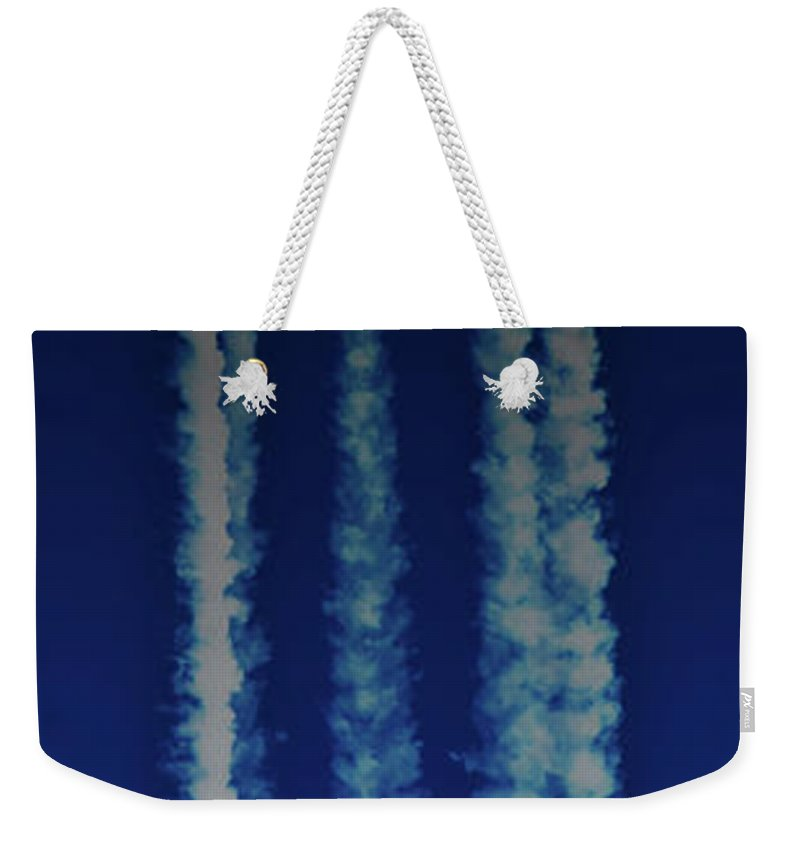 Moon Weekender Tote Bag featuring the photograph Racing For The Moon by Chris Lord