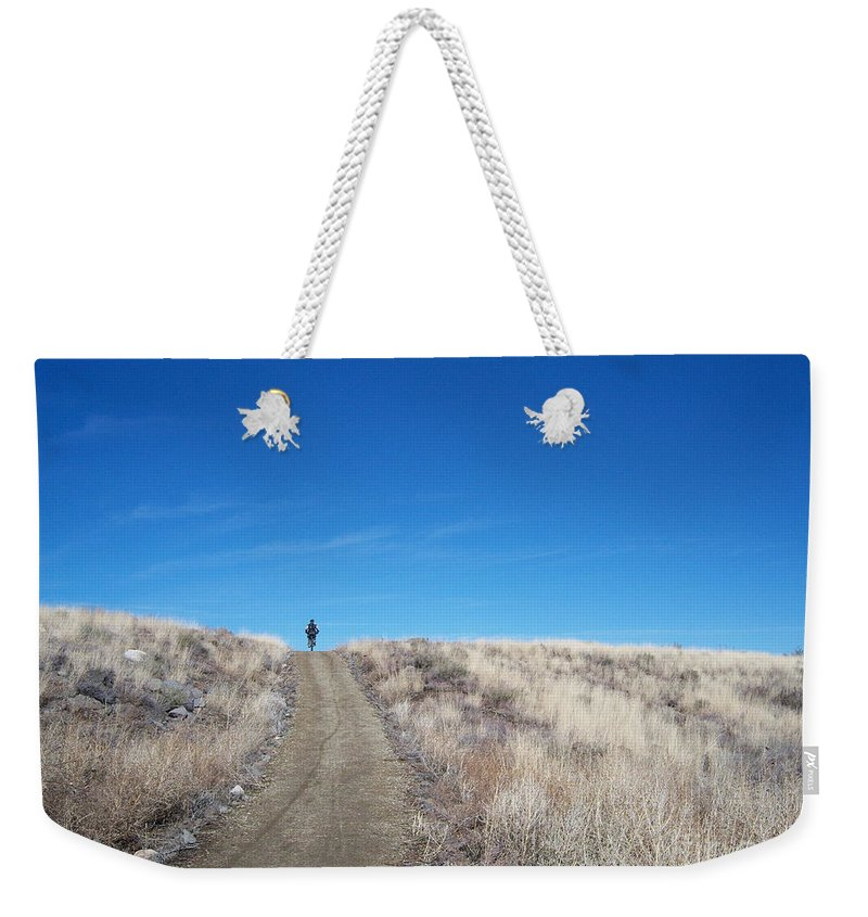 Racing Bike Weekender Tote Bag featuring the photograph Racing Over The Horizon by Heather Kirk