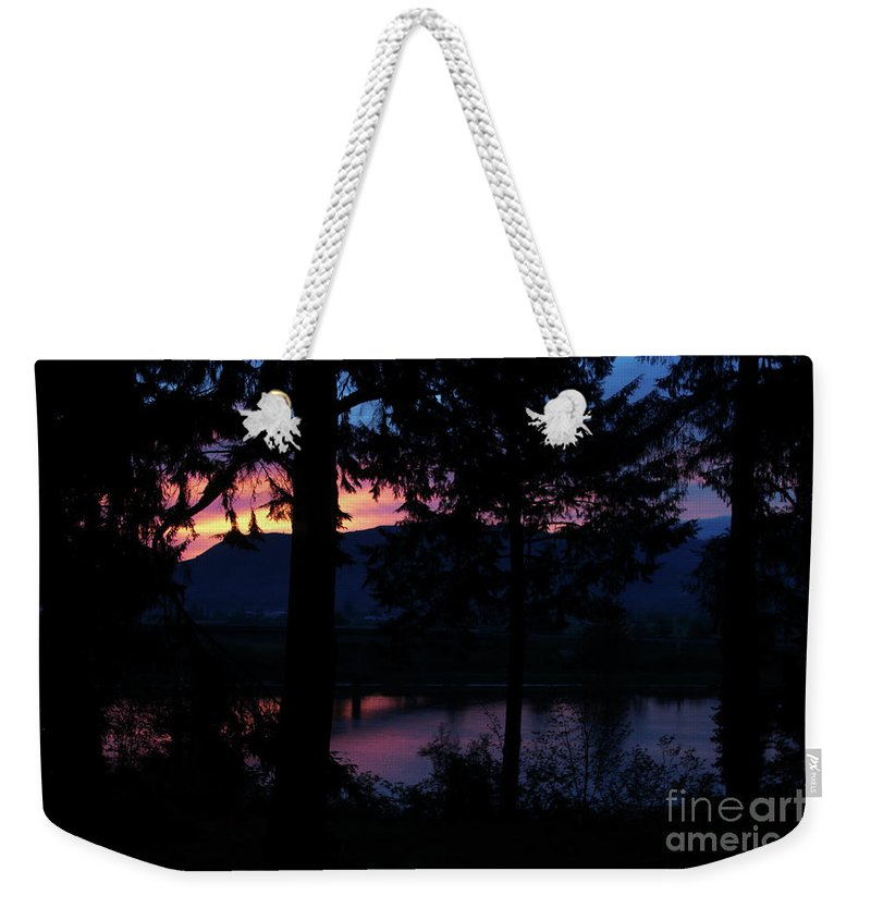 Nature Weekender Tote Bag featuring the photograph Radiant Dawn Begins by Michelle Williamson