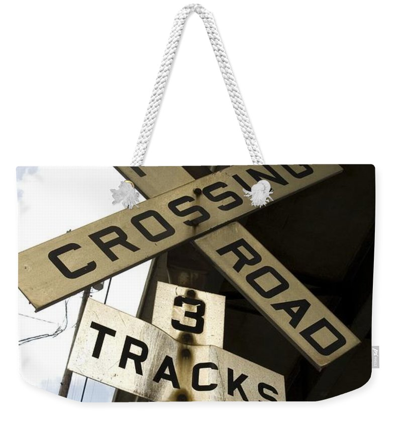 Railroad Sign Weekender Tote Bag featuring the photograph Rail Road Sign by Sara Stevenson