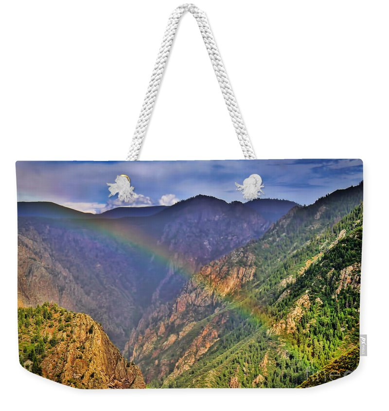Summer Weekender Tote Bag featuring the photograph Rainbow Across Canyon by Janice Pariza