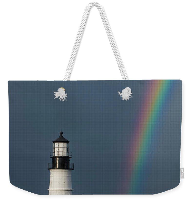 Lighthouse Weekender Tote Bag featuring the photograph Rainbow At Portland Head Light by Jesse MacDonald