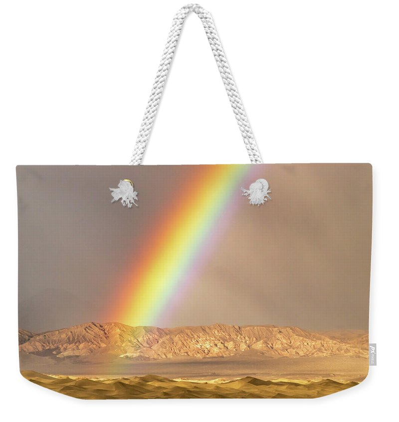 Death Valley National Park Weekender Tote Bag featuring the photograph Rainbow Over Mesquite Dunes by Bill Gallagher