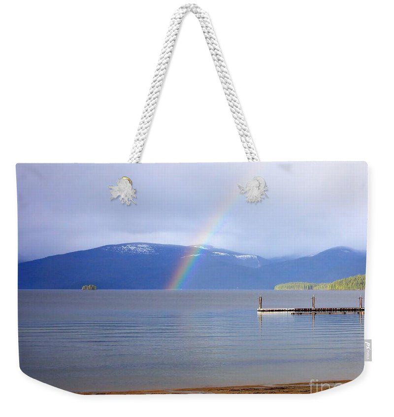 Rainbow Weekender Tote Bag featuring the photograph Rainbow Over Priest Lake by Carol Groenen