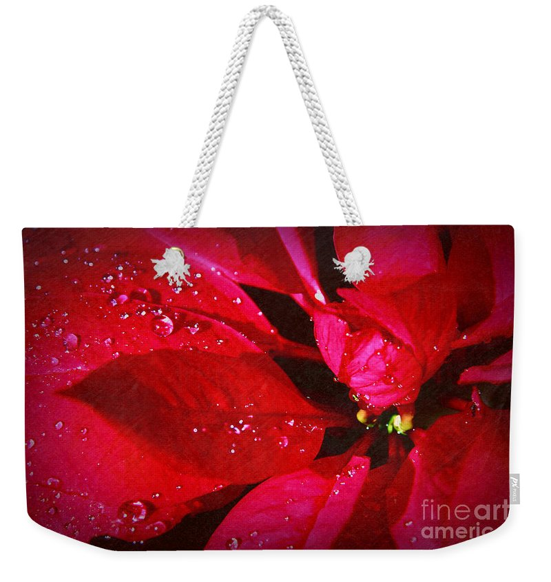 Raindrops On Red Poinsettia Weekender Tote Bag featuring the photograph Raindrops On Red Poinsettia by Mariola Bitner