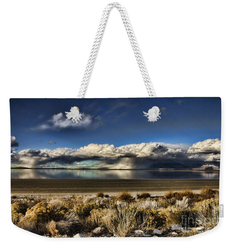 Cloud Weekender Tote Bag featuring the photograph Rainfall Over The Salt Lake by Douglas Barnard