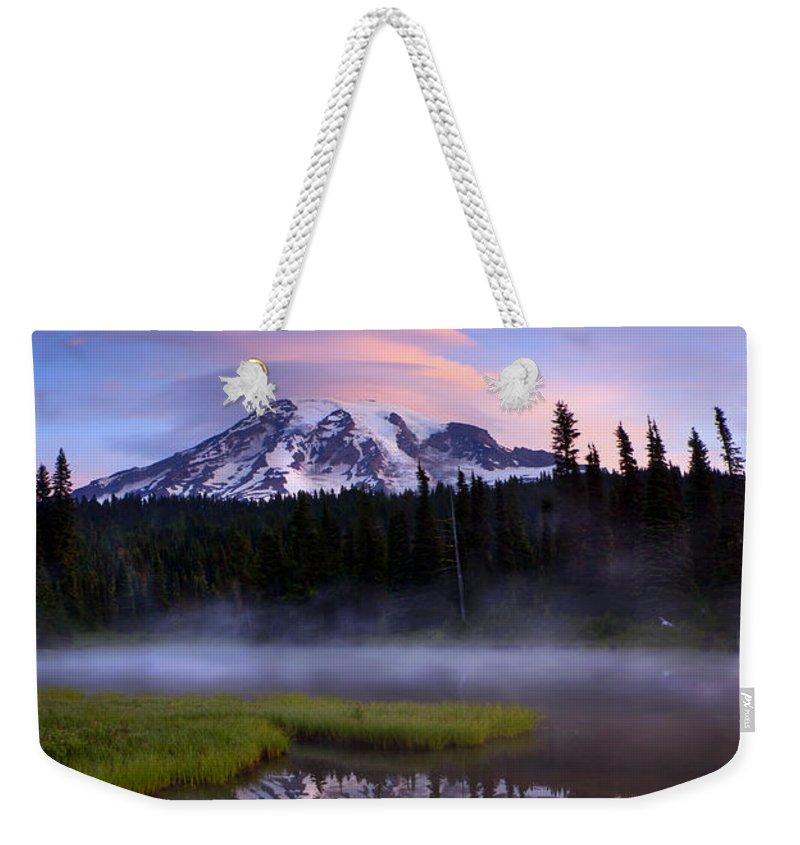 Rainier Weekender Tote Bag featuring the photograph Rainier Sunrise Cap by Mike Dawson