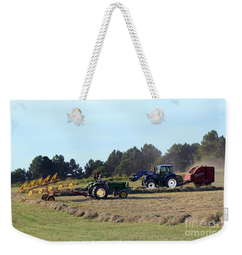 Tractor Weekender Tote Bag featuring the photograph Raking And Baling Hay In Texas by Catherine Sherman