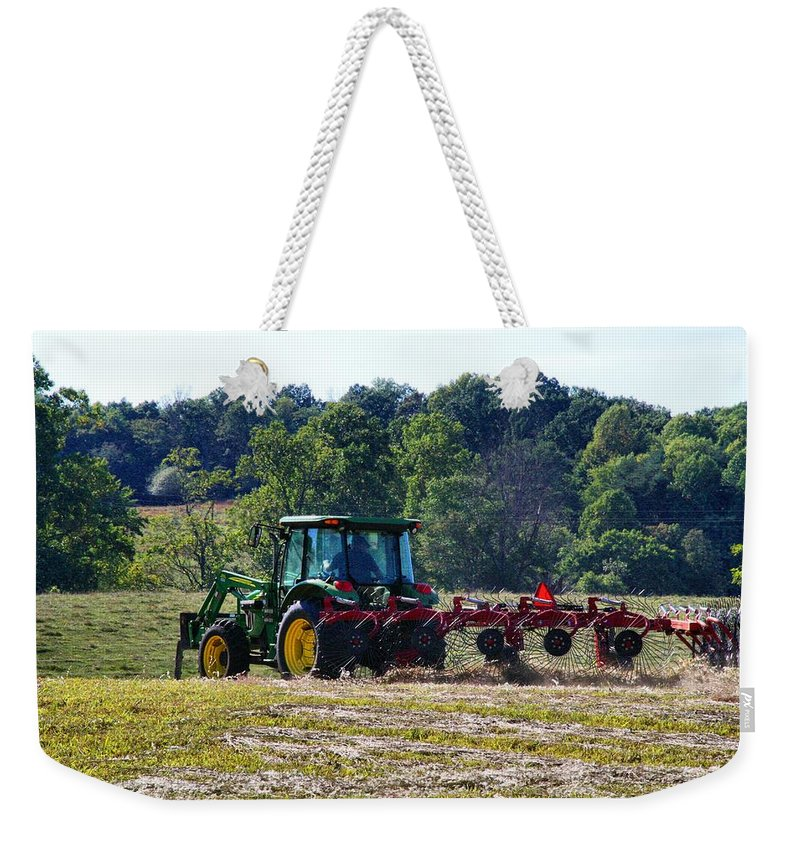 Hay Weekender Tote Bag featuring the photograph Raking The Hay by Kathryn Meyer