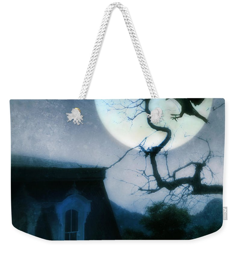 House Weekender Tote Bag featuring the photograph Raven Landing On Branch In Moonlight by Jill Battaglia