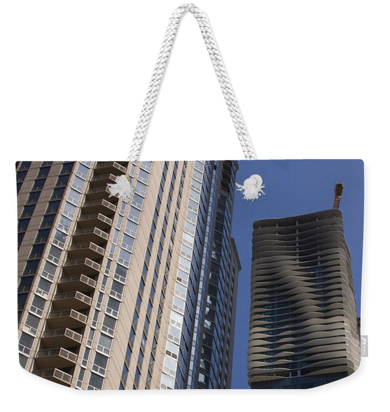 Chicago Wind Windy City Building Sky Skyscraper Blue Tall High Big Large Urban Metro Weekender Tote Bag featuring the photograph Reaching High by Andrei Shliakhau