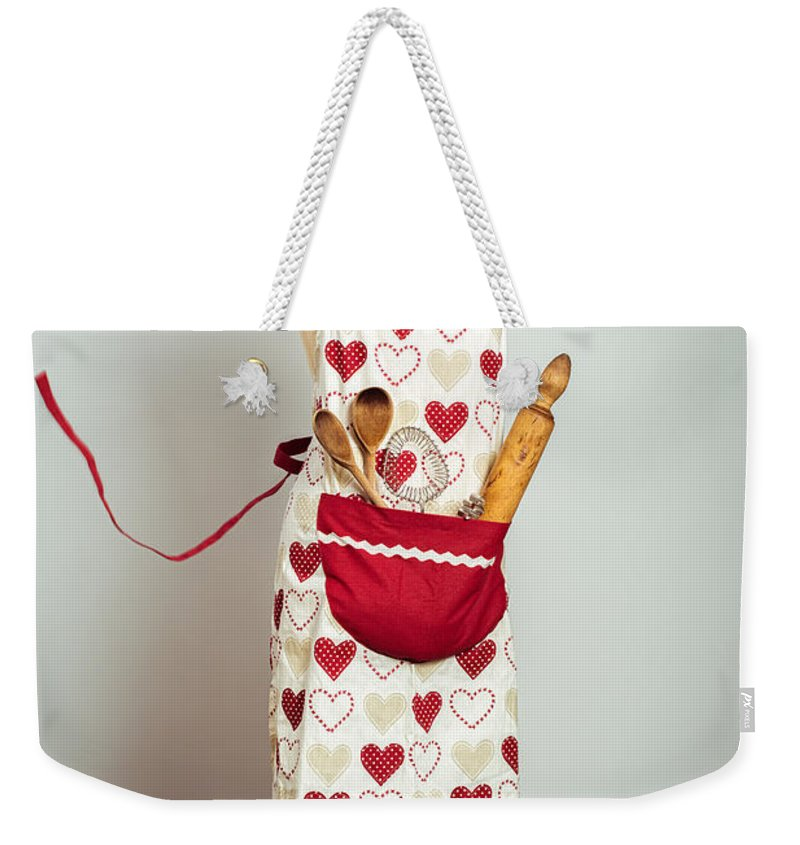 Baking Weekender Tote Bag featuring the photograph Red Baking Apron by Amanda Elwell