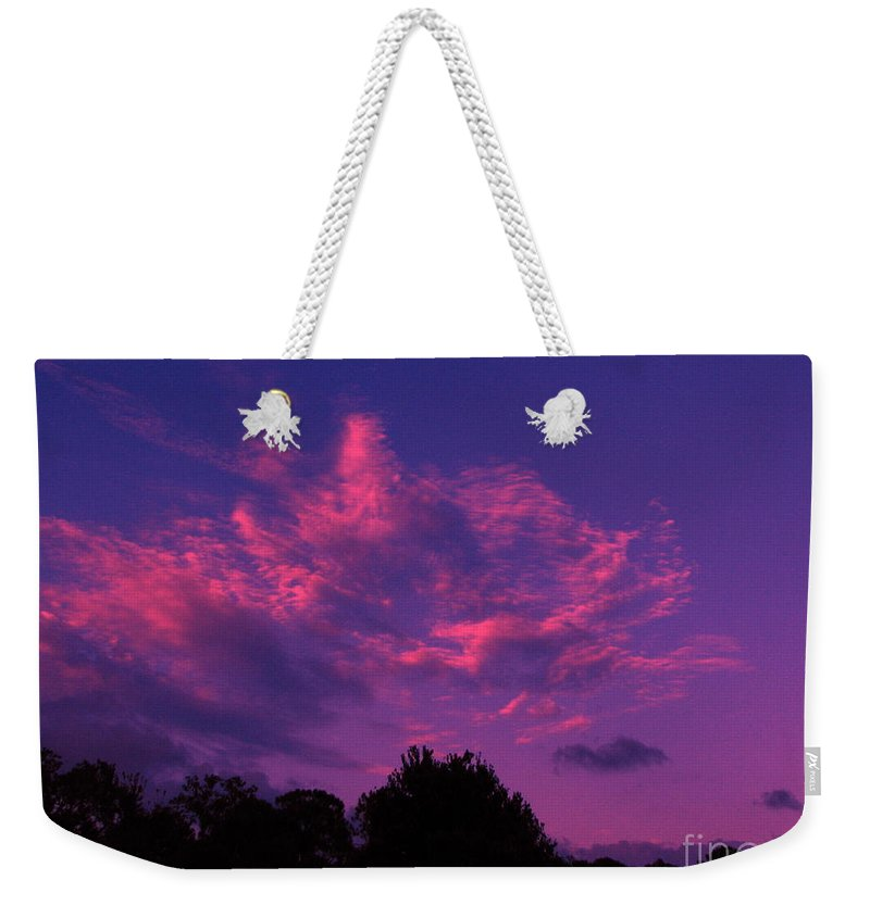 Night Scape Weekender Tote Bag featuring the photograph Red Blue Sky by Greg Patzer