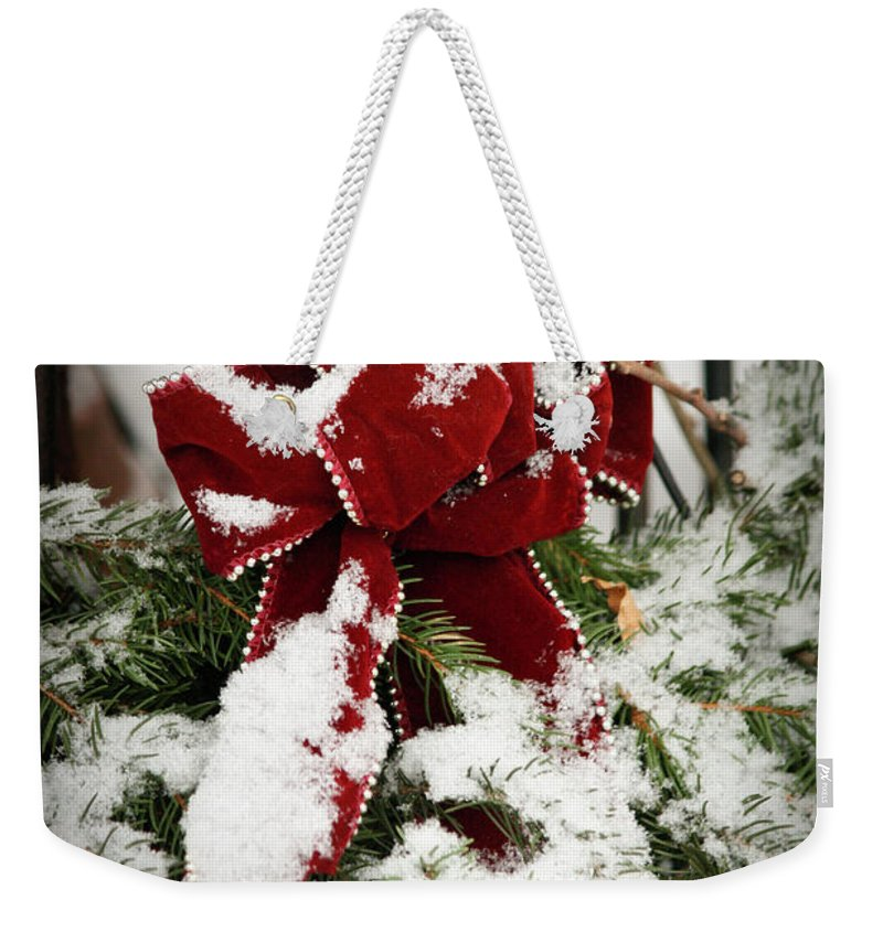 Winter Weekender Tote Bag featuring the photograph Red Bow On Pine Bough by Teresa Mucha