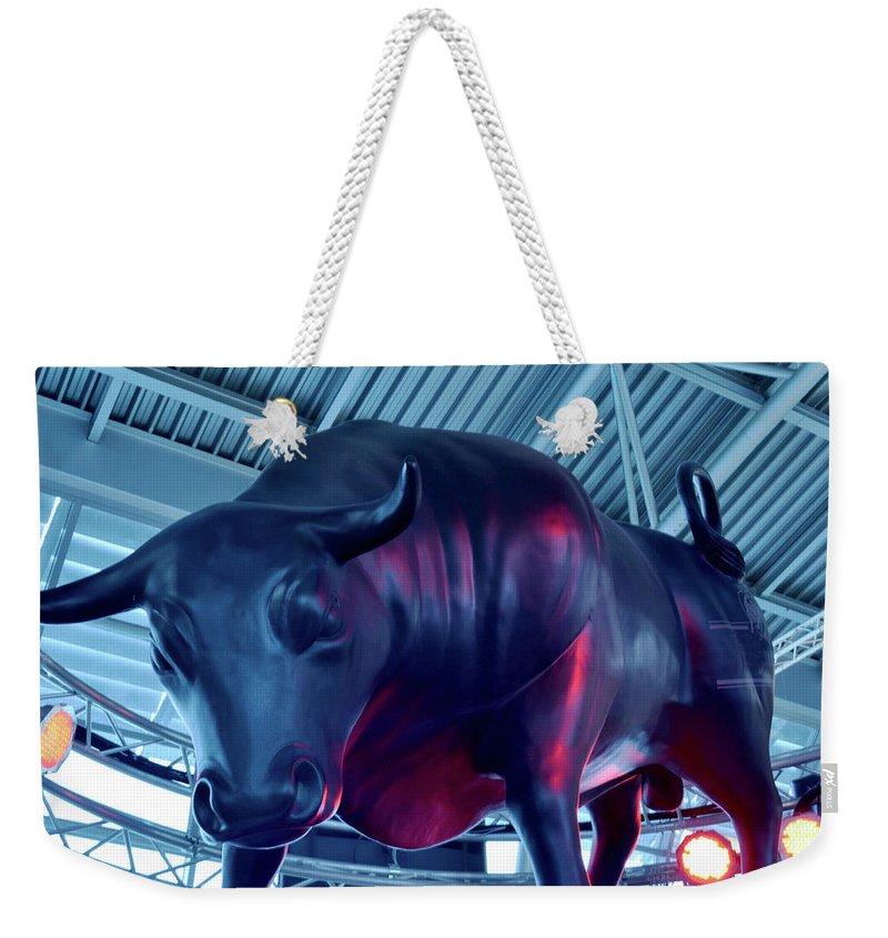 Torros Weekender Tote Bag featuring the photograph Red Bulls by LUPE Photographer