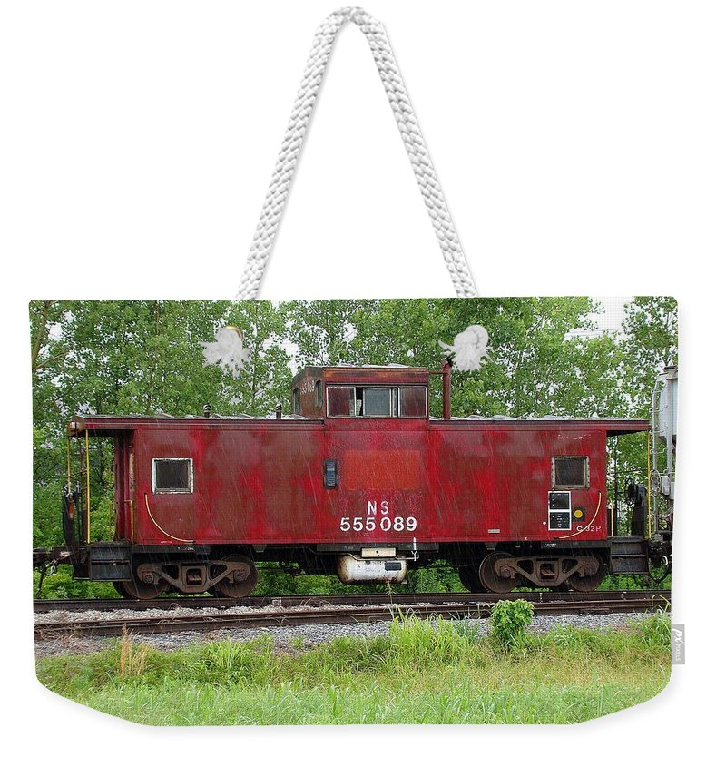 Train Weekender Tote Bag featuring the photograph Red Caboose In The Rain by J R Seymour