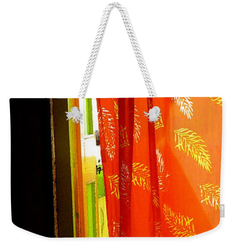 Red Weekender Tote Bag featuring the photograph Red Curtain In The Doorway by Ian MacDonald