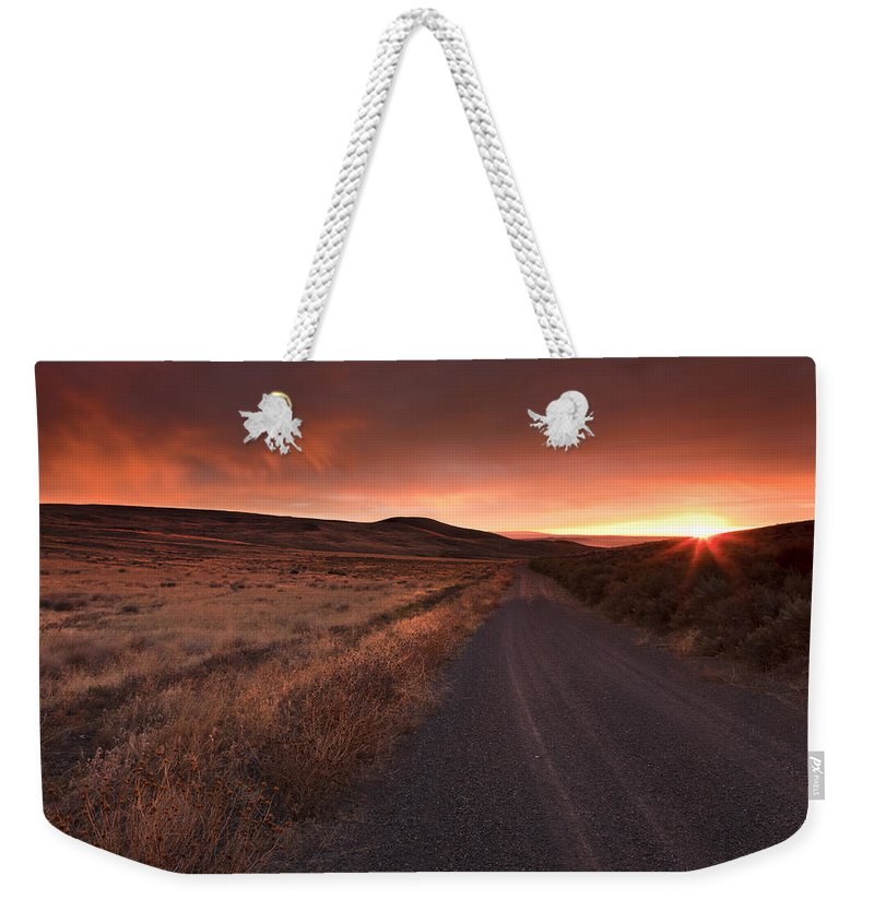 Country Road Weekender Tote Bag featuring the photograph Red Dawn by Mike Dawson