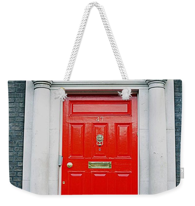 Red Weekender Tote Bag featuring the photograph Red Door by John Hughes