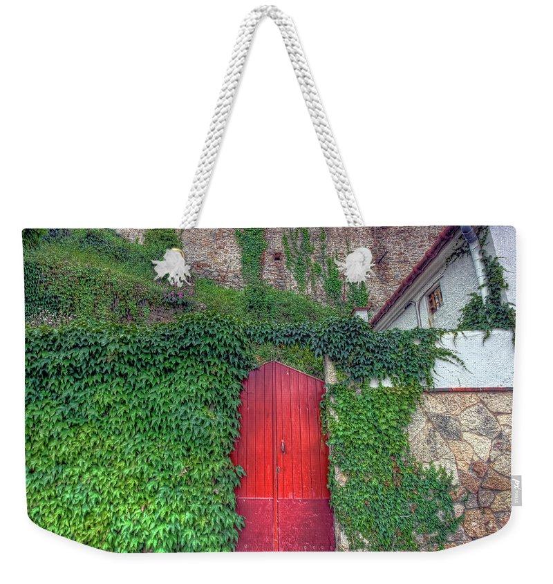 Spain Weekender Tote Bag featuring the photograph Red Door by Nadia Sanowar