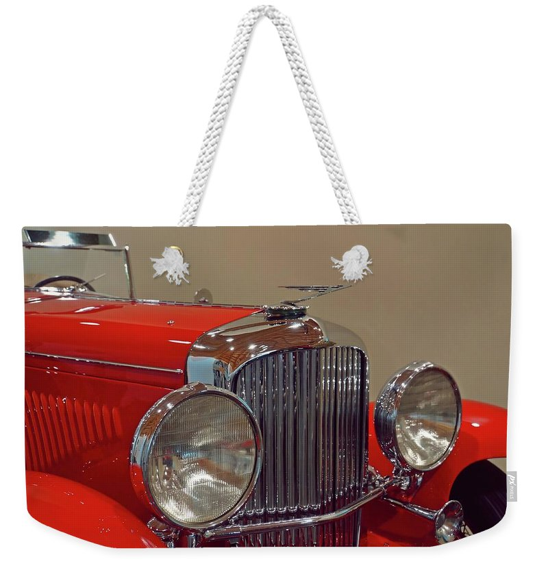 Automobile Weekender Tote Bag featuring the photograph Red Duesenberg Beauty by Patricia Strand