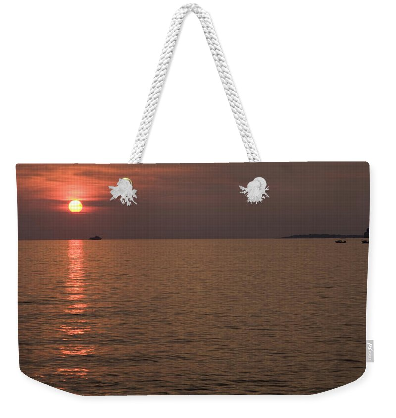 Sea Weekender Tote Bag featuring the photograph Red Dusk Over Pula by Ian Middleton