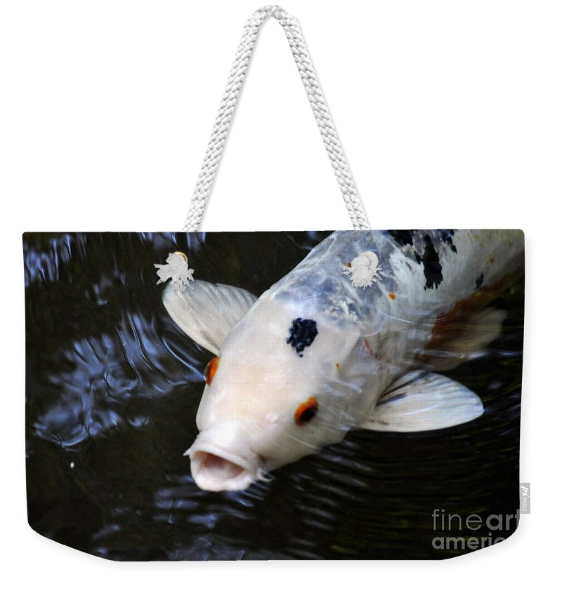 Clay Weekender Tote Bag featuring the photograph Red Eyes by Clayton Bruster
