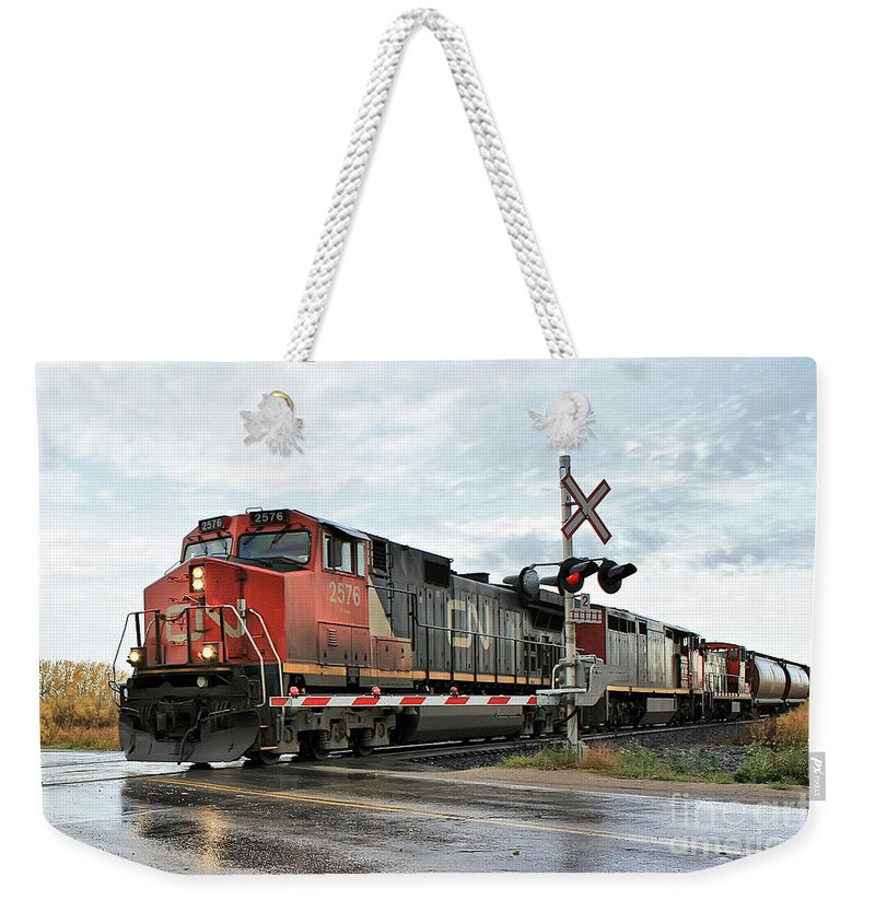 Train Weekender Tote Bag featuring the photograph Red Locomotive by Teresa Zieba