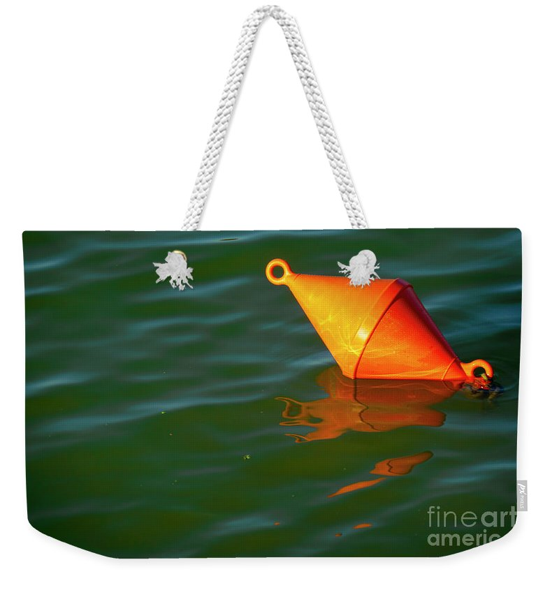 Red Weekender Tote Bag featuring the photograph Red Mooring Buoy by Vladi Alon