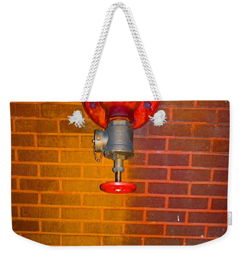 Photograph Weekender Tote Bag featuring the photograph Red Pipe by Thomas Valentine