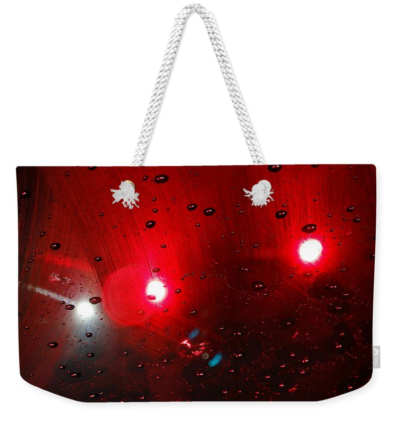 Red Rain Reflection Lights Abstract Droplets Weekender Tote Bag featuring the photograph Red Reflection by Vincent Verrillo