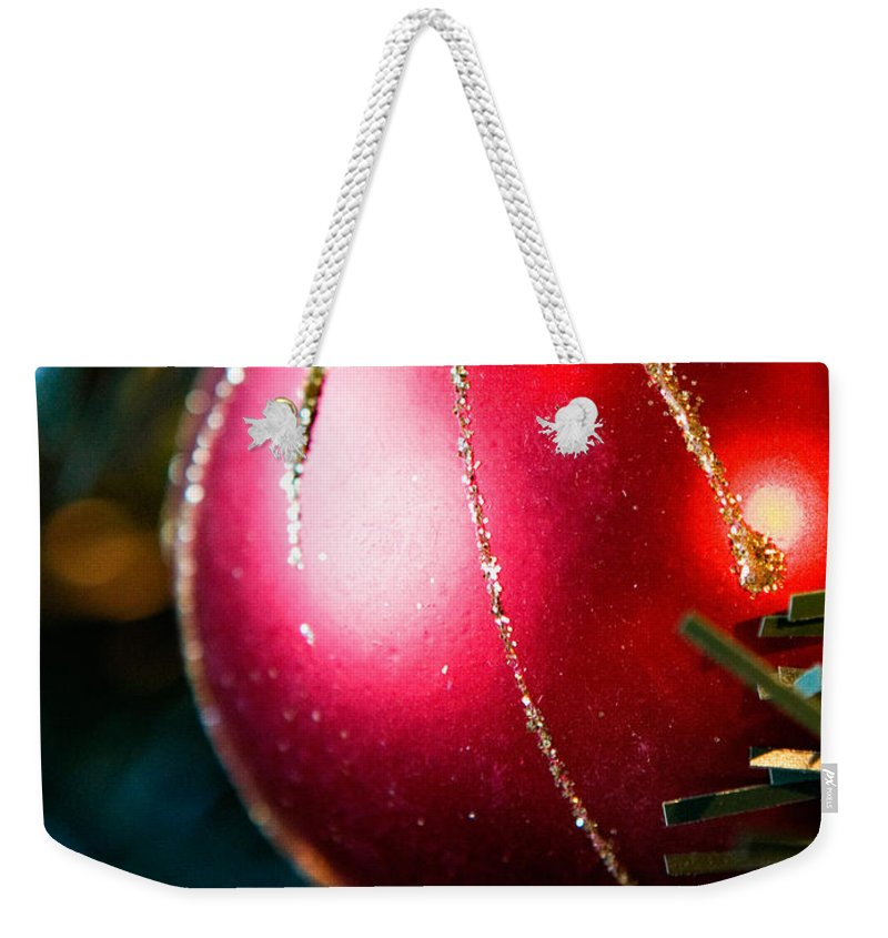 Red Weekender Tote Bag featuring the photograph Red Shiny Ornament by Marilyn Hunt