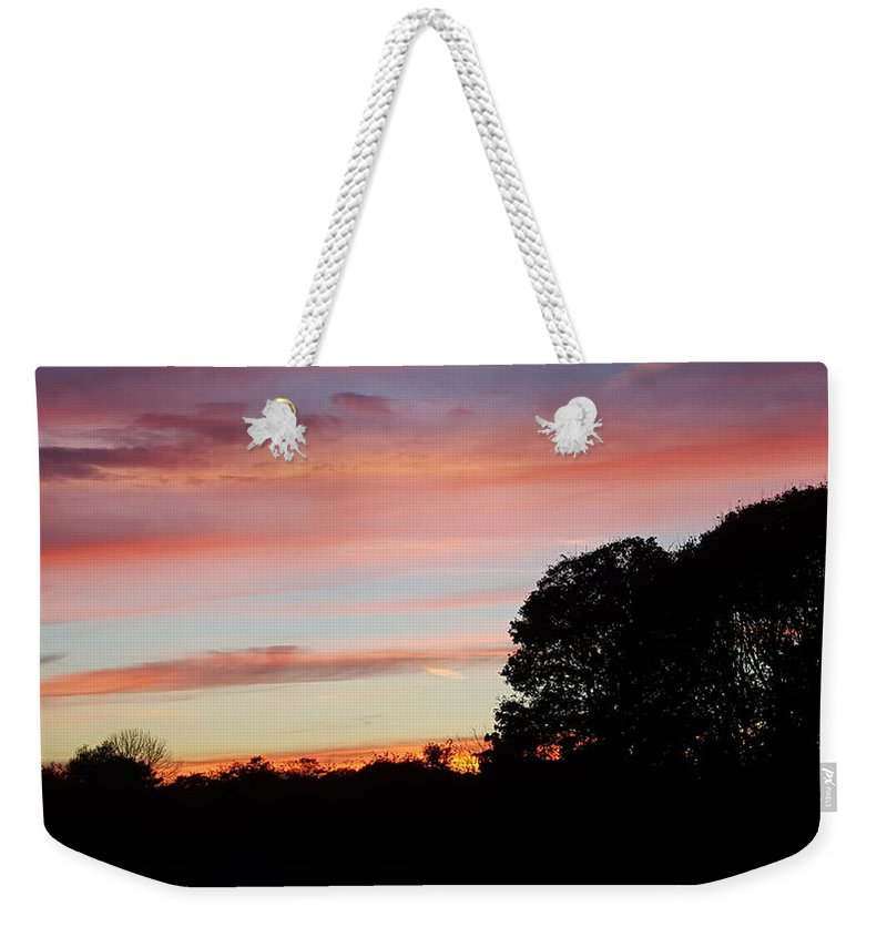 Silhouette Of Large And Small Trees With Foliage Weekender Tote Bag featuring the photograph Red Sky At Night by Harriet Harding