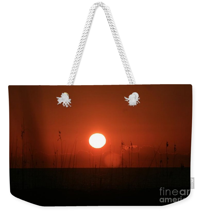 Sunset Weekender Tote Bag featuring the photograph Red Sunset And Grasses by Nadine Rippelmeyer
