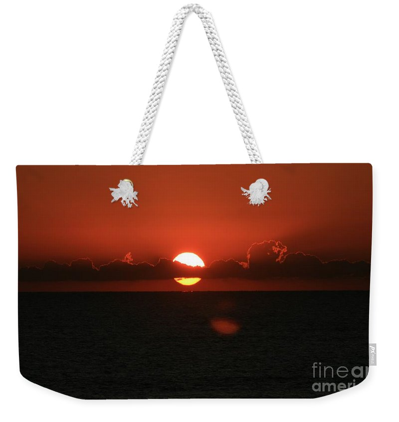 Sunset Weekender Tote Bag featuring the photograph Red Sunset Over The Atlantic by Nadine Rippelmeyer