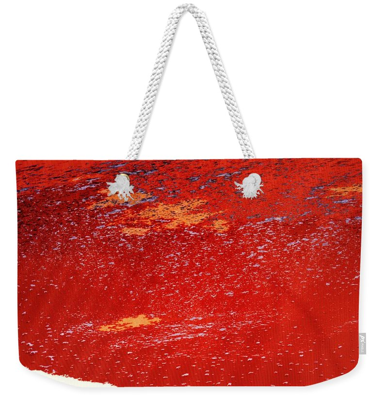 Red Weekender Tote Bag featuring the photograph Red Surf On The Beach by Ian MacDonald