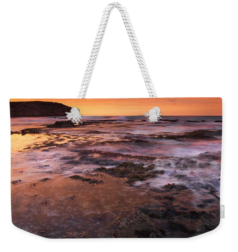 Sunrise Weekender Tote Bag featuring the photograph Red Tides by Mike Dawson