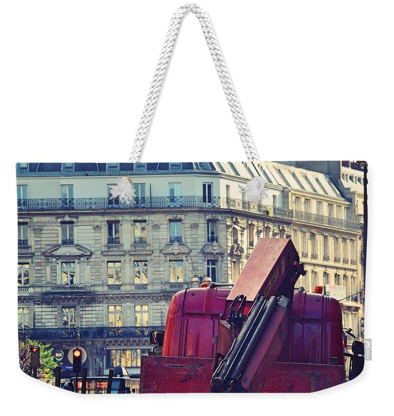 Paris Weekender Tote Bag featuring the pastel Red Truck In Paris Street by Valerie Dauce