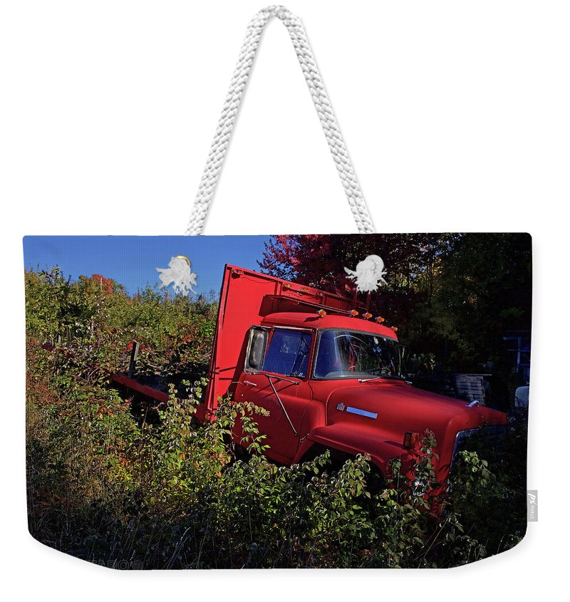 Red Weekender Tote Bag featuring the photograph Red Truck by Jerry LoFaro