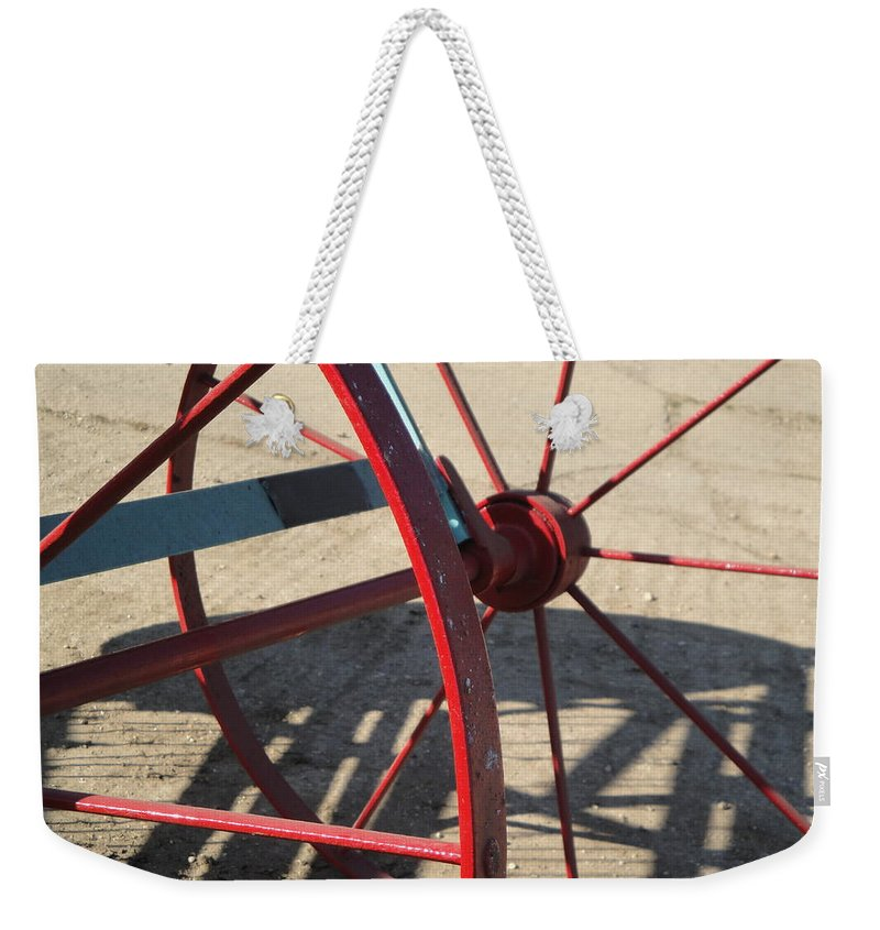 Wheel Weekender Tote Bag featuring the photograph Red Waggon Wheel by Susan Baker
