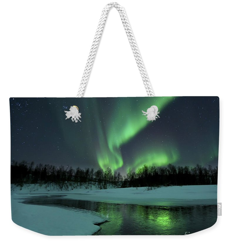 Green Weekender Tote Bag featuring the photograph Reflected Aurora Over A Frozen Laksa by Arild Heitmann