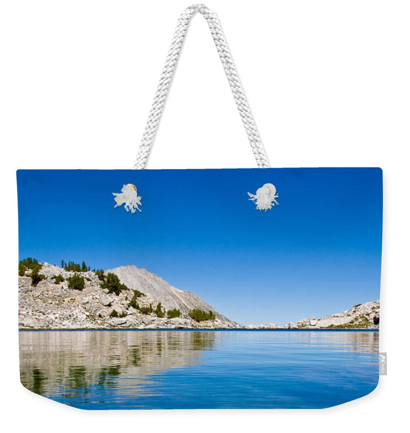 Treasure Lake Weekender Tote Bag featuring the photograph Reflecting On Treasure by Chris Brannen