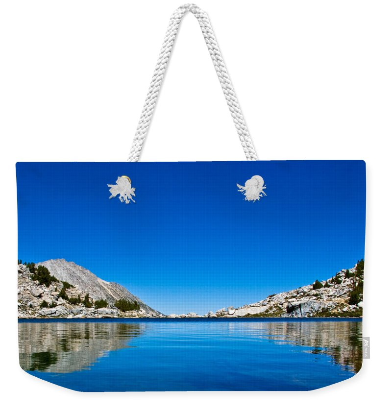 Treasure Lake Reflection Weekender Tote Bag featuring the photograph Reflecting On Treasure Lake by Chris Brannen