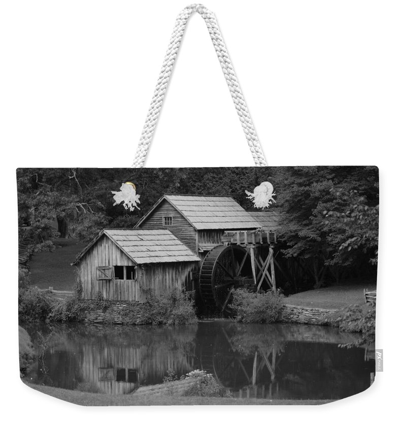 Mabry Mill Weekender Tote Bag featuring the photograph Reflecting The Mill by Eric Liller