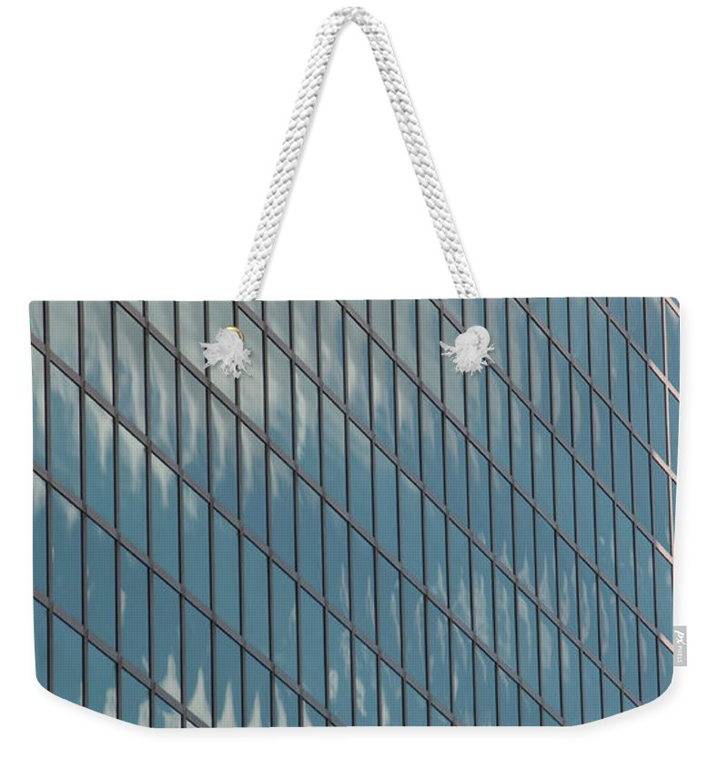 Photography Weekender Tote Bag featuring the photograph Reflection Clouds On Building by Steven Natanson